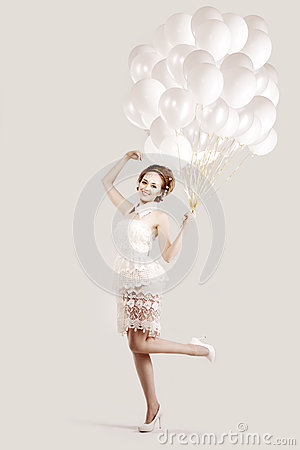 Woman with balloons in hands