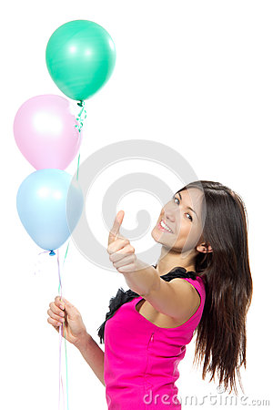 Woman with balloons smiling and showing thumb up