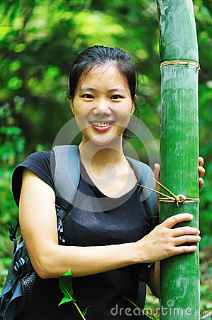 Woman with bamboo tree