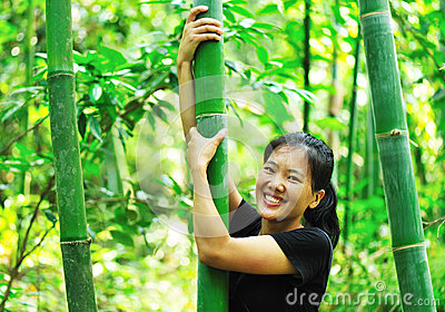 Woman and bamboo tree