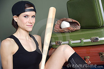 Woman with baseball bat glove ball luggage
