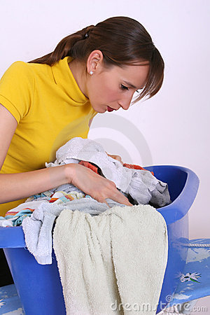 Woman and basket with dirty clothing