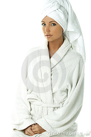 Woman with bath robe and towel