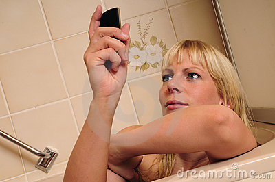 Woman in  bath and using cellphone