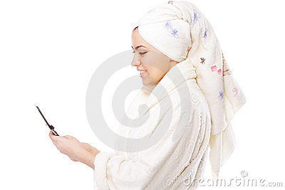 Woman in bathrobe with phone sideview