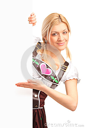 Woman in bavarian costume holding a panel