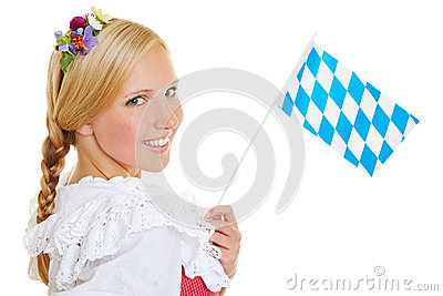 Woman with bavarian flag and dirndl