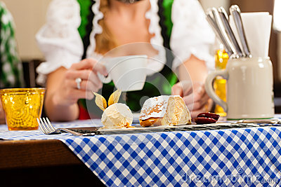 woman in Bavarian Tracht in restaurant or pub