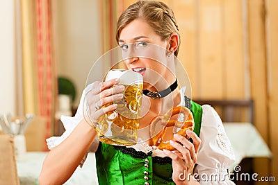 Woman in Bavarian Tracht in restaurant or pub