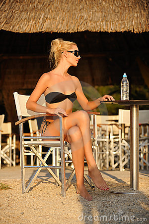 Woman in the beach bar