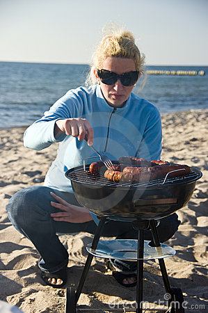 Woman and beach barbecue