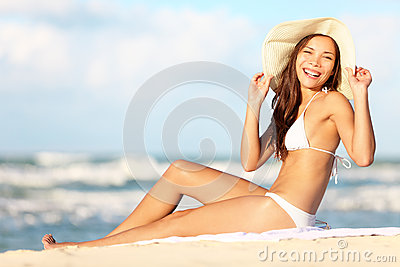 Woman on beach enjoying sun happy