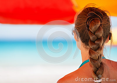 Woman on beach looking into distance