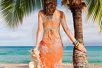 woman beach palm tree