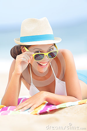 Woman on beach with sunglasses