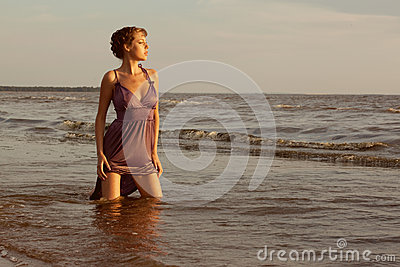 Woman on the beach at sunset.