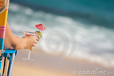 Woman on Beach with Tropical Drink