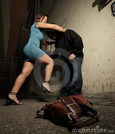 Woman beating up the assailant