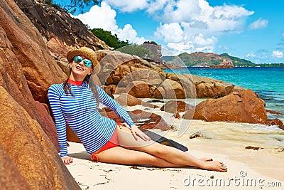 woman beautiful beach wearing rash guard seychelles curieuse island 41084664 Dating A Dominican Woman