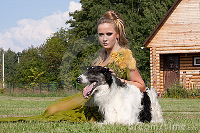 The woman in a beautiful dress with borzoi