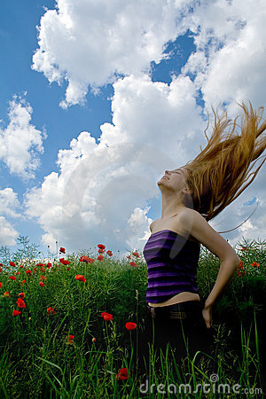 Woman with beautiful hair in splendid green meadow
