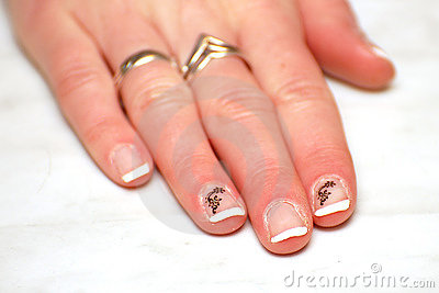 Woman beautiful hand with painted white nails