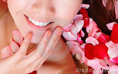 Woman beautiful lips with pink and red roses