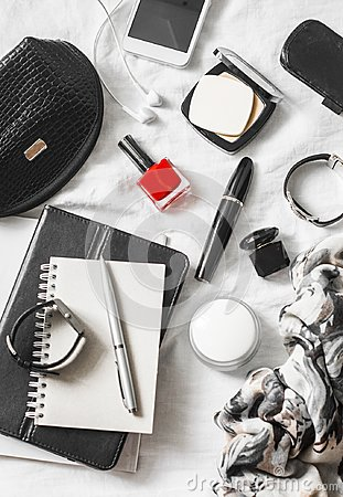 Free Woman Beauty Accessories On A Light Background, Top View. Cosmetic Bag, Red Nail Polish, Mascara, Watch, Bracelet, Scarf, Perfume, Stock Photo - 103289410
