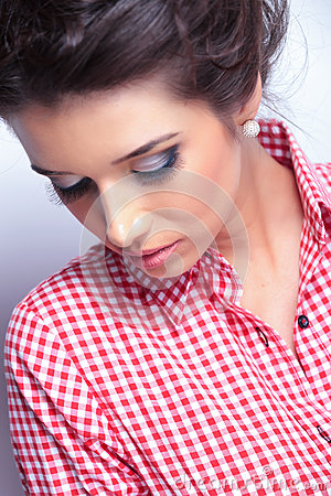 Woman with beauty makeup looking down