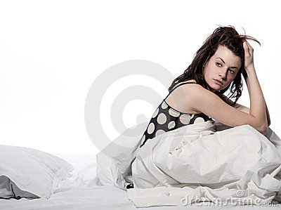 Woman in bed awakening tired insomnia hangover