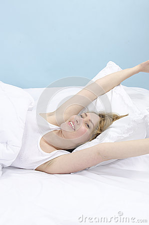 Woman in bed daydreaming