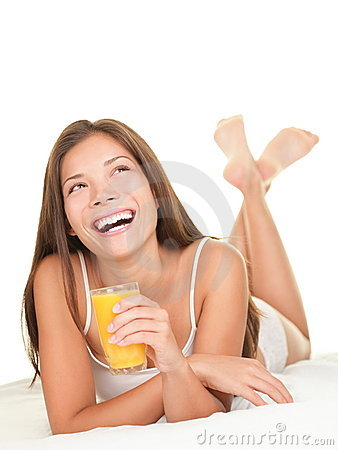 Woman in bed drinking Juice