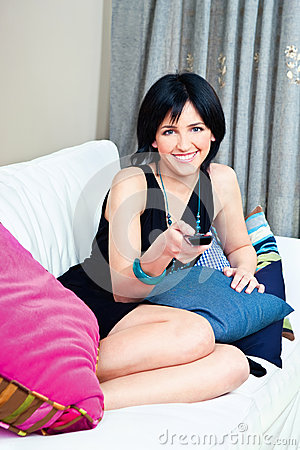 Woman on bed with remote controller