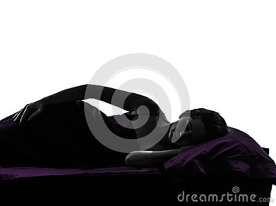 Woman in bed sleeping lying on side silhouette