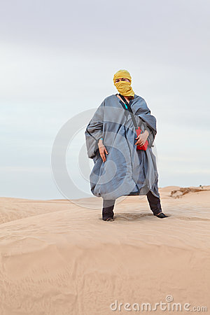 Woman in bedouin clothes in desert