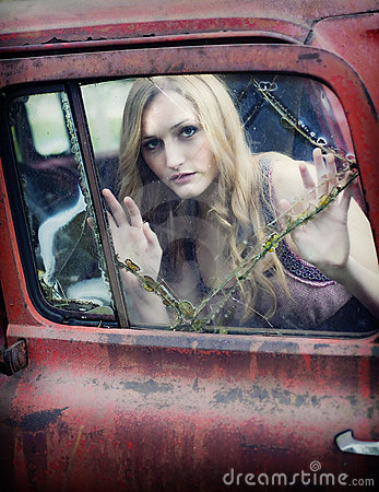 Woman behind broken window