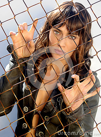 Woman Behind Chain Link
