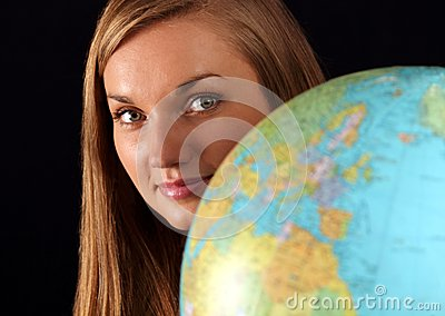 Woman behind globe