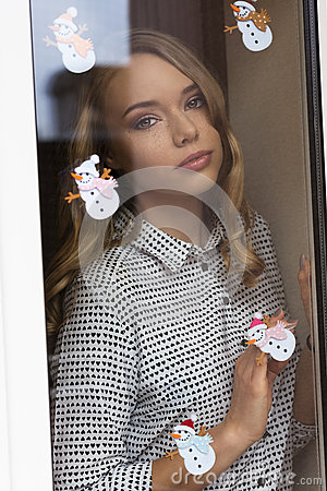 Free Woman Behind Window In Winter Time Stock Images - 81108184
