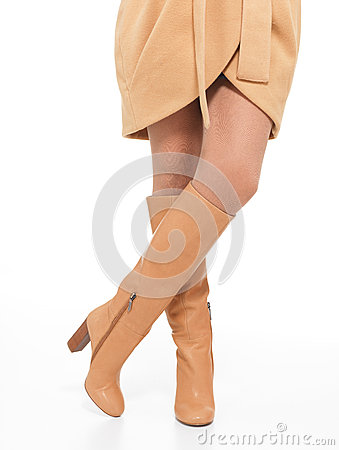 Woman in beige autumn boots