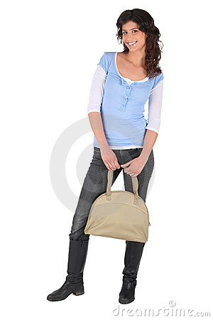 Woman with a beige handbag