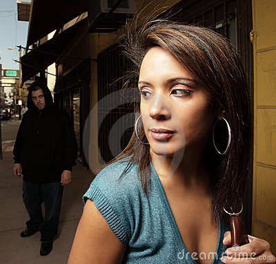 Woman being stalked by a thug
