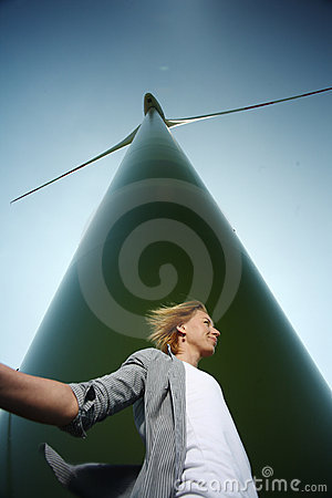 Woman below wind turbine