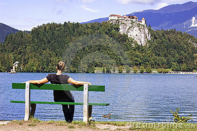 Woman on Bench, enjoys summer day