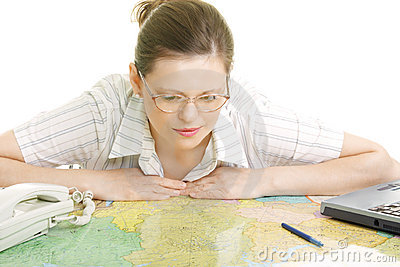 Woman bending over map