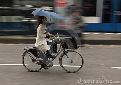 Woman on bicycle Editorial Stock Photo