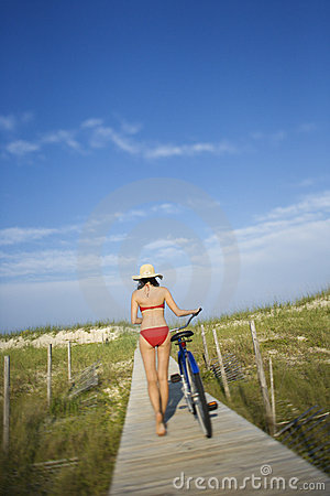 Woman with Bicycle on Boardwalk