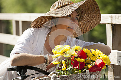 Woman with bicycle and flowers
