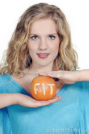 Woman with big citrus fruit