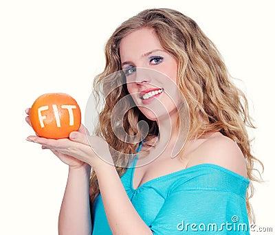 Woman with big citrus fruit